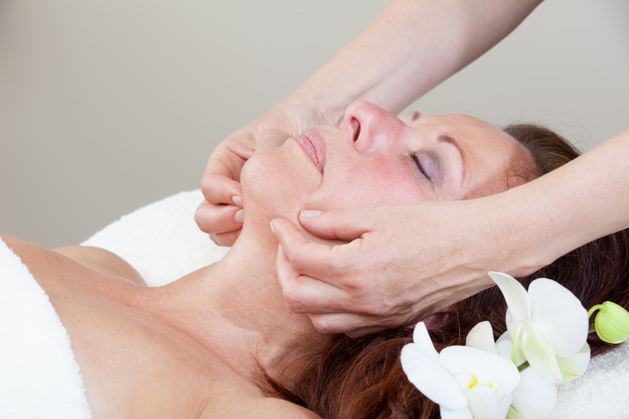 Mature Woman having relaxing head and face massage