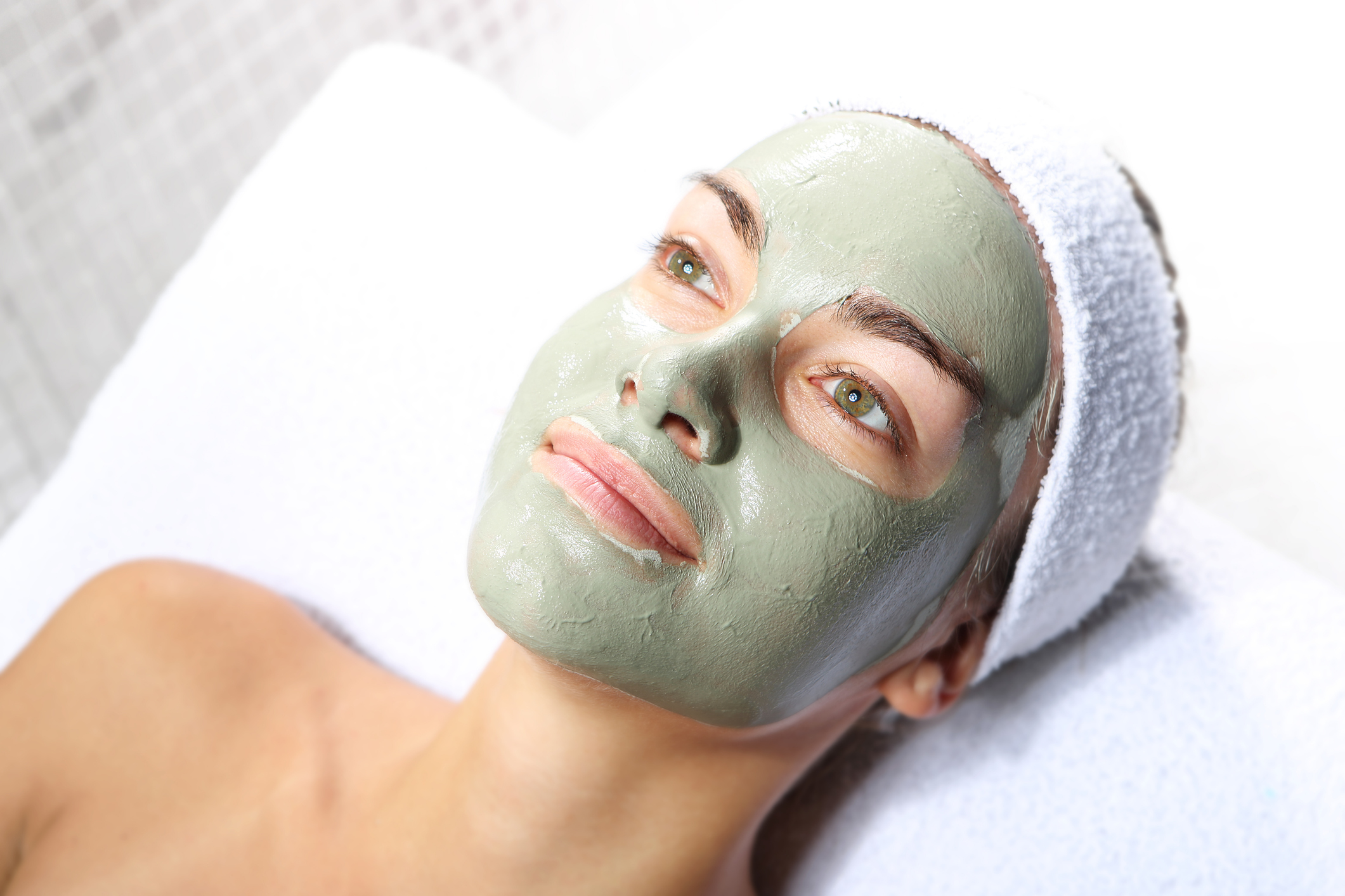 beautiful woman relaxing with herbal face mask